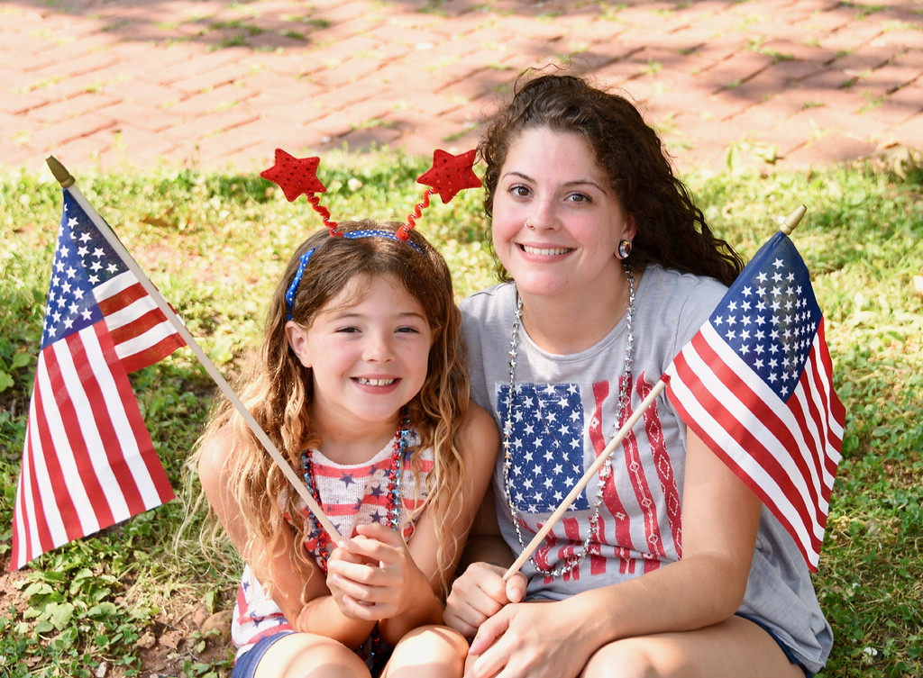 . Jesi Yost � For Digital First Media Ezra King, 8, and her Mom, Aubrey Fisher, found a shady spot to watch the Pottstown Fourth of July Parade.