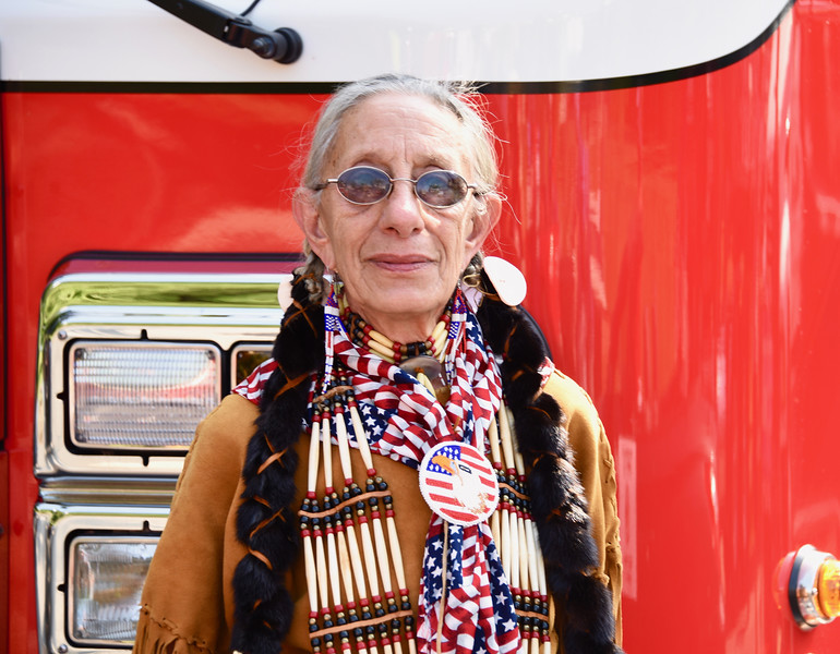 """Jesi Yost — For Digital First Media<br /> """"Proud American"""" Patricia Camaho Harbach rides with the Norco Fire Company in the Pottstown July 4th Parade."""