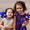 Jesi Yost — For Digital First Media<br /> Sisters Autumn Rose Watkins, 3, and Faith Mae Watkins, 4, wait for the Pottstown Fourth of July Parade to go by on High Street.