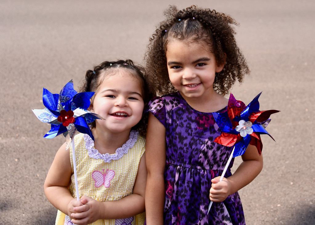 . Jesi Yost � For Digital First Media Sisters Autumn Rose Watkins, 3, and Faith Mae Watkins, 4, wait for the Pottstown Fourth of July Parade to go by on High Street.