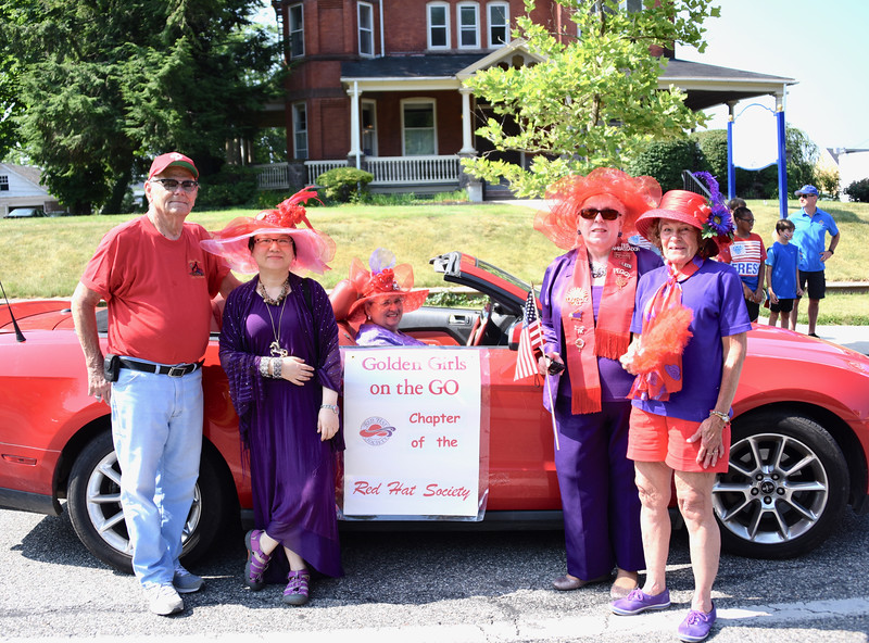 Jesi Yost — For Digital First Media<br /> Members of the Golden Girls on the Go Chapter of the Red Hat Society prepare to ride in the Fourth of July Parade.