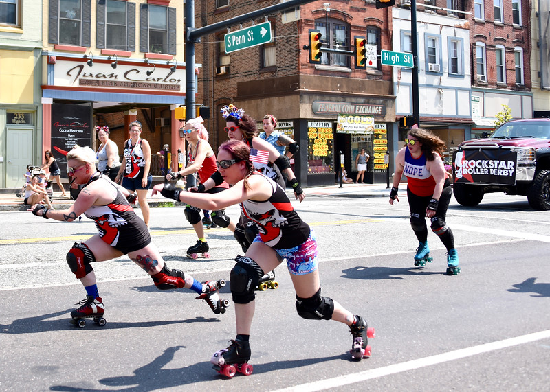 Jesi Yost — For Digital First Media<br /> Members of Rockstar Roller Derby of Pottstown skate down High Street during the Pottstown Fourth of July Parade.