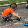 MONICA SAGER — DIGITAL FIRST MEDIA<br /> Mosaic Community Land Trust's side walk chalk became a racing ground for children's toys.