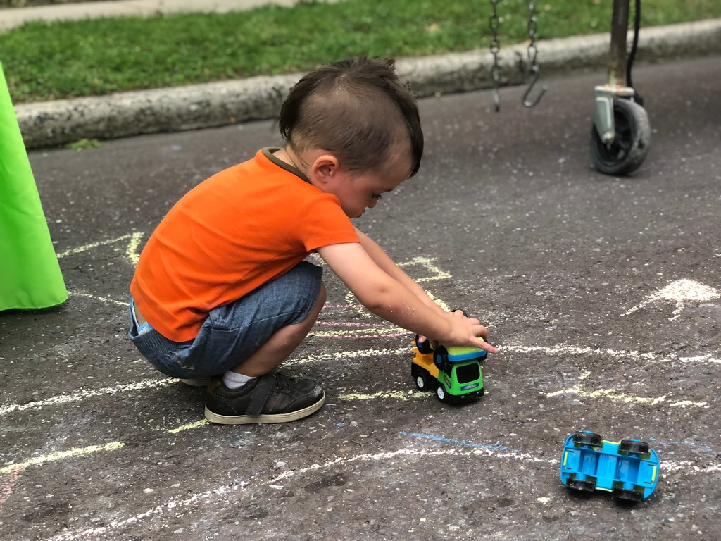 . MONICA SAGER � DIGITAL FIRST MEDIA Mosaic Community Land Trust�s side walk chalk became a racing ground for children�s toys.