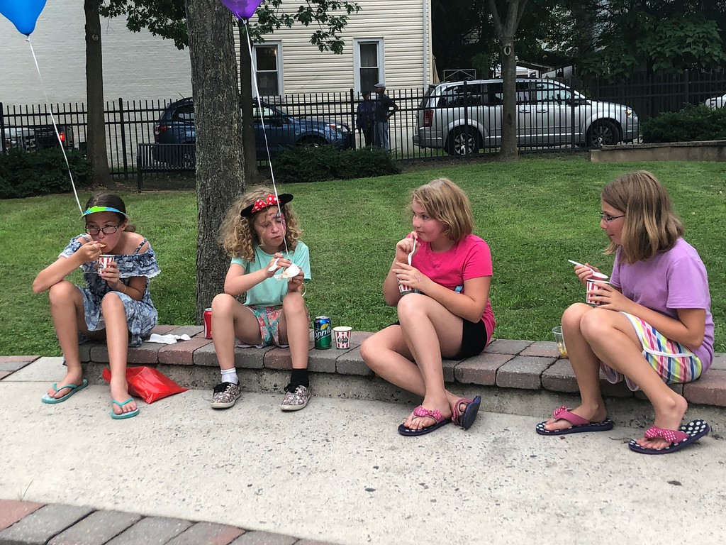 . MONICA SAGER � DIGITAL FIRST MEDIA Kids enjoy free water ice at National Night Out at the Washington and Chestnut Street Park.