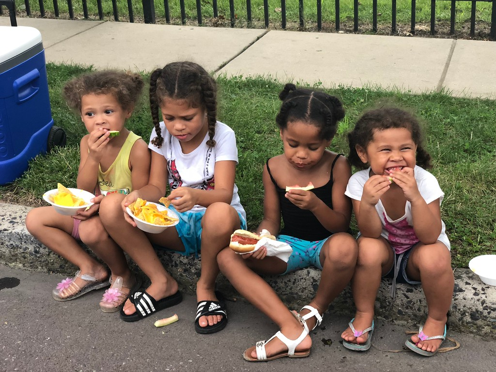 . MONICA SAGER � DIGITAL FIRST MEDIA Nachos, burgers, hot dogs and watermelon were served at Pottstown�s celebration of National Night Out.