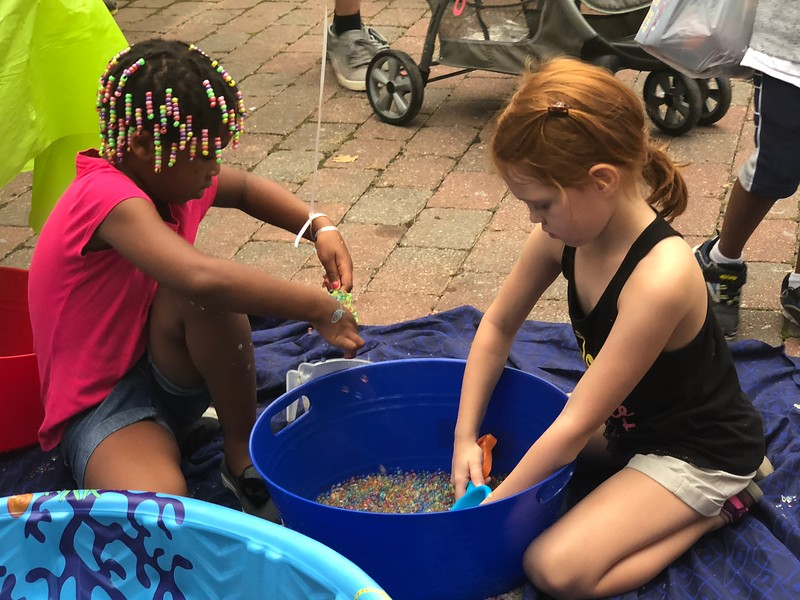 MONICA SAGER — DIGITAL FIRST MEDIA<br /> Pottstown Children's Discovery Center had a sensory bead activity at National Night Out.