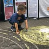 MONICA SAGER — DIGITAL FIRST MEDIA<br /> Mosaic Community Land Trust hosted a sidewalk chalk event at the National Night Out celebration.