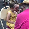 MONICA SAGER — DIGITAL FIRST MEDIA<br /> Logan Morton receives face paint from the Grace Early Learning Center.