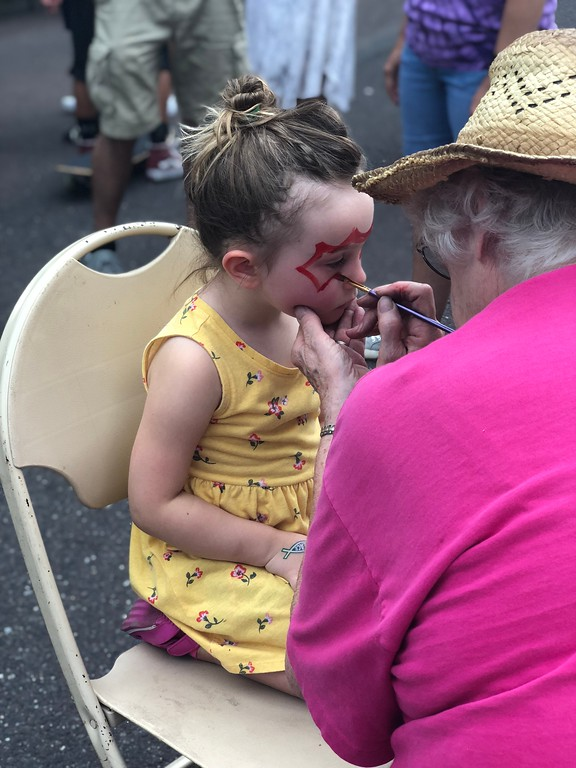 . MONICA SAGER � DIGITAL FIRST MEDIA Logan Morton receives face paint from the Grace Early Learning Center.