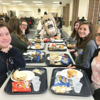 The food in the high school cafeteria tastes better when Trojan Man is at the table.