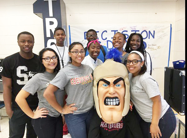 """Trojan Man visits with Pottstown High School students during """"Decision Day,"""" when their college and career choices after graduation become final."""