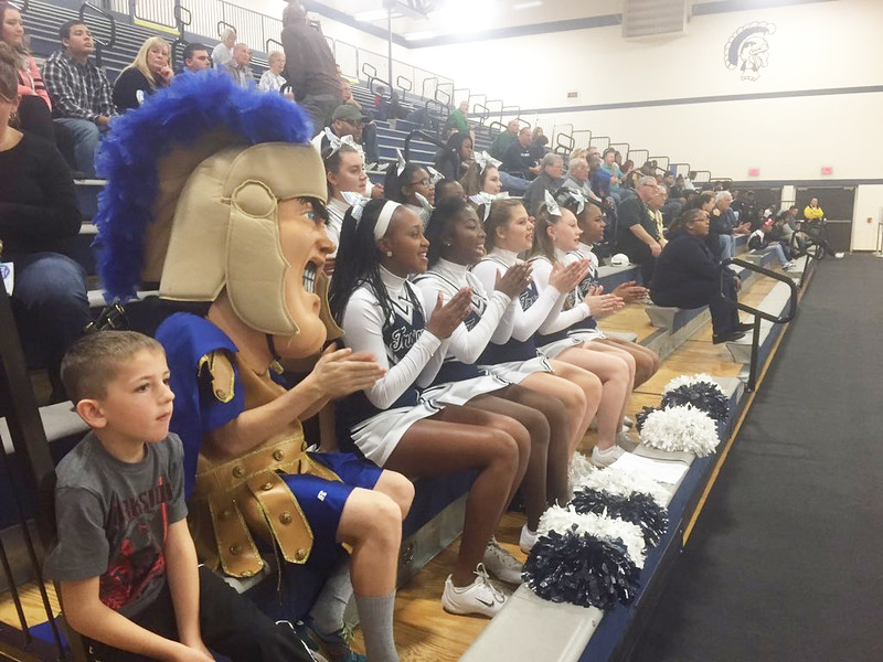 Trojan Man joins the cheerleading squad during a basketball game at Pottstown High School.