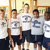 Dual Pride: Pottstown High School wrestlers, from left, A.J. Ecker, Alex Caballero, coach Nick Wade, Destin Snyder and Anthony Wiggins mean business.