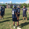 Football coach Gary Rhodenbaugh shows his Pottstown Pride as he gives some last instructions as the Trojans prepare for the opening home game against Sun Valley.