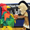 Its a Mascot Face-Off! Trojan Man wrestles for the ball with the Pottstown Farm Market rooster at an iBall United fundraiser to fight cancer.