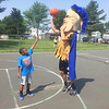 Trojan man teaches this youngster that there are no limits to how high you can reach during Unity Day at Pottstown's Spruce Street Park.