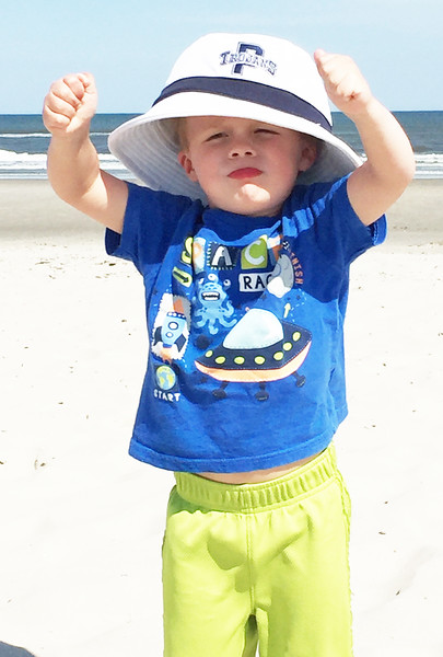 Caden Anspach, son of Pottstown School District Director of Co-Curricular Activities, Steve Anspach is showing his Pottstown Trojan Pride on the beach at Ocean City NJ.