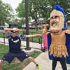 Pottstown High School senior Nate Camacho matches his moves with Trojan Man during a visit Rupert Elementary, to his neighborhood school.