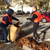 Evan  Brandt -- Digital First Media<br /> Hill School students Rachel Schaaf, 17 and Call Coothgenthe, 15, rake leaves in Pottstown's Evans Street parking lot Friday during PottstownCARES Day.