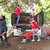 Evan Brandt -- Digital First Media<br /> Moasic Community Garden manager Laura Washington and Michael Eze, 15, were part of the train of Hill School students moving mulch donated by John Jermacans Style of Skippack and shoved by John and Christian DeVol, 17.