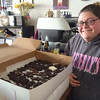 Evan Brandt -- Digital First Media<br /> Kristen Sirbak, owner of Beverly's Pastry, got up at 4:30 a.m. Friday to finish a batch of 500 chocolates to be given out during the YMCA's Halloween Safehouse that night. The project was arranged by The Hill School for PottstownCARES Day.