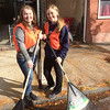 Evan Brandt -- Digital First Media<br /> Pottstown High School junior Emilie Lineman, left, was joined by another Emily, fellow junior Emily Jerdon, cleaning up King Street Thursday for PottstownCARES Day.