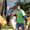 John Strickler - Digital First Media<br /> Godwin Lue with the Vanguard Group cleans up piles of debris behind a Walnut Street home.