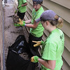 John Strickler - Digital First Media<br /> Carly Lange, Ethan Andersen and Rahil Goyal sweep up and bag twigs and leaves between homes on Walnut Street.
