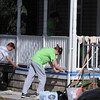 John Strickler - Digital First Media<br /> Hill School's Phillip Bell and Max Putt sand down a porch deck for repainting in Pottstown.