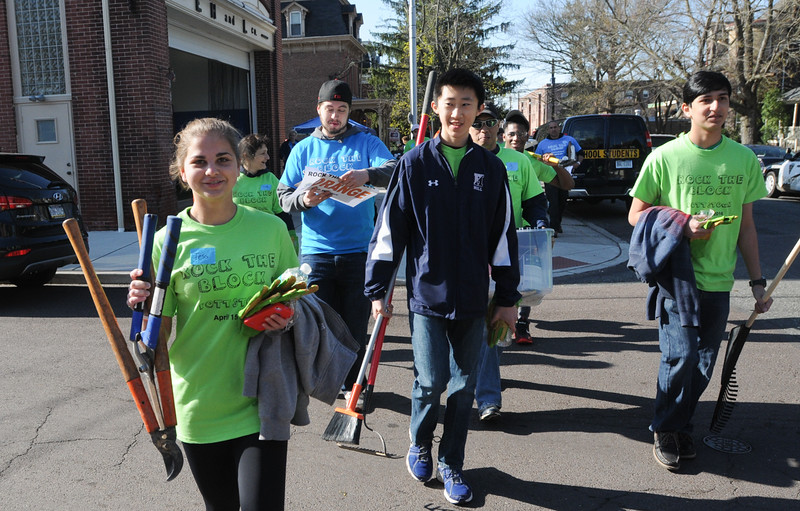 John Strickler - Digital First Media<br /> Volunteers start out carrying various garden tools Frdiay morning as part of the 'Rock the Block' cleanup effort in Pottstown.
