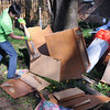 John Strickler - Digital First Media<br /> Hill School student Shaarug Khan breaks up old cabinets that were sitting in a pile of debris behind a Walnut Street home during the 'Rock the Block' cleanup effort Friday in Pottstown.