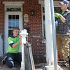 John Strickler - Digital First Media<br /> Aiden Ryan and Travis Webb do prep work on a Chestnut Street porch as part of the 'Rock the Block' event.