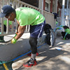 John Strickler - Digital First Media<br /> Isaiah Mayes scraps a porch for repainting during the 'Rock the Block event.