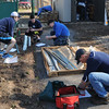 John Strickler - Digital First Media <br /> Mark Nelson form Hill school overseeing work by Pottstown High and Hill students , Nathan Wilson, Travis DeBruyn and Ryan Dinkelocker build a shed at the community garden on Chestnut Street.