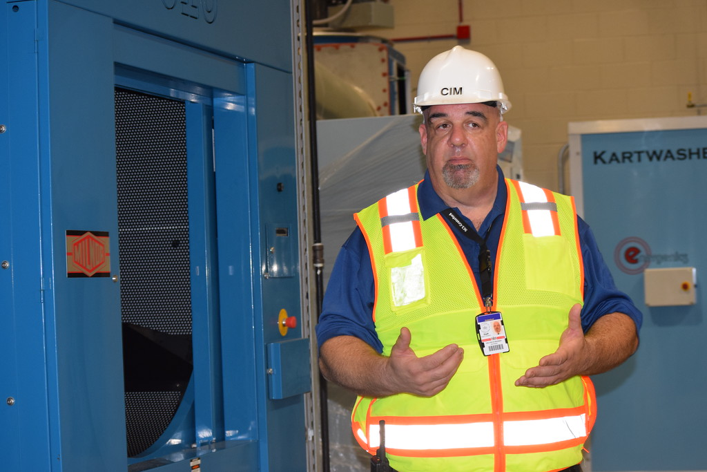 . Walter Grunder, critical incident manager at Graterford State Prison, give a tour of the massive laundry facility at the new SCI Phoenix.  Marian Dennis -- Digital First Media
