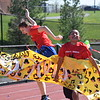Marian Dennis – Digital First Media<br /> Students rushed through specially made banners displayed at the start of the track Wednesday during the Daniel Boone Special Olympics event.