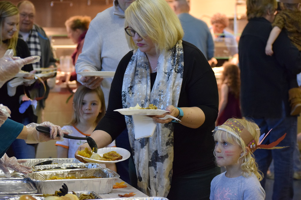 . St. Teresa of Calcutta School in Limerick welcomed families of their students to enjoy an early Thanksgiving meal after watching the children perform Thanksgiving songs. Marian Dennis -- Digital First Media