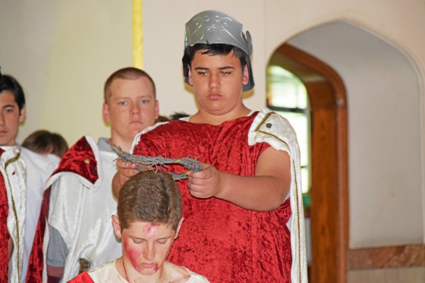. Jesus is given a crown of thorns by a soldier during St. Aloysius� Living Stations performance Wednesday afternoon. Marian Dennis � Digital First Media