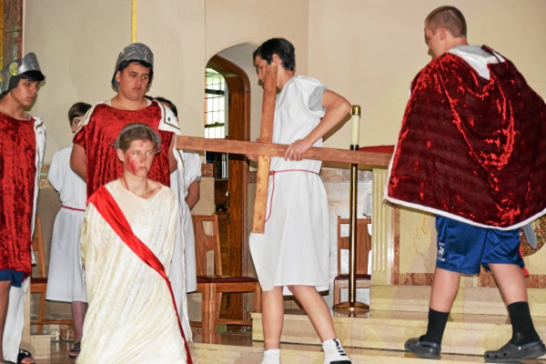 . Students at St. Aloysius reenacted the Stations of the Cross Wednesday afternoon before Easter break. In the second station, Jesus is forced to carry his cross. Marian Dennis � Digital First Media