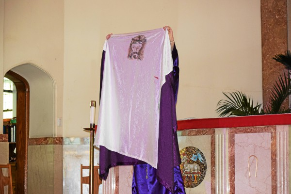 . Veronica, played by Kiersten Donnelly, holds up the shroud used to wipe the face Jesus during the sixth station. The Living Stations were performed by St. Aloysius students on Wednesday. Marian Dennis � Digital First Media