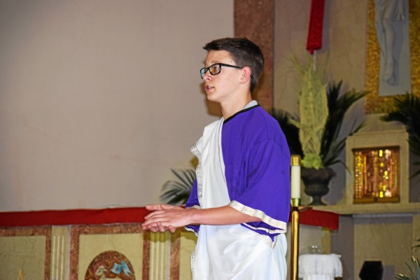 . Liam Paul plays Pontius Pilate Wednesday during a Living Stations performance done by students at St. Aloysius. In this station, Pontius Pilate condemns Jesus to death at the demand of the people. Marian Dennis � Digital First Media