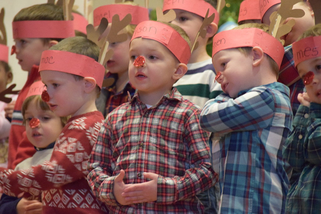 . Kids sang and pantomimed a variety of Christmas songs Friday as they kicked off the holiday weekend with a Christmas concert at St. Teresa of Calcutta. Marian Dennis -- Digital First Media