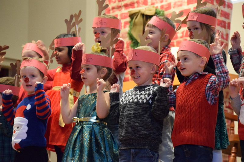 Kids were all smiles Friday at St. Teresa of Calcutta School as they kicked off their holiday break with some songs for their families.<br /> Marian Dennis -- Digital First Media