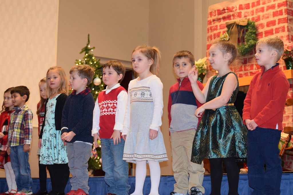 . In front of a cozy chimney scene that the children helped decorate, St. Teresa of Calcutta School students performed a variety of Christmas favorites just before the holiday. Marian Dennis -- Digital First Media