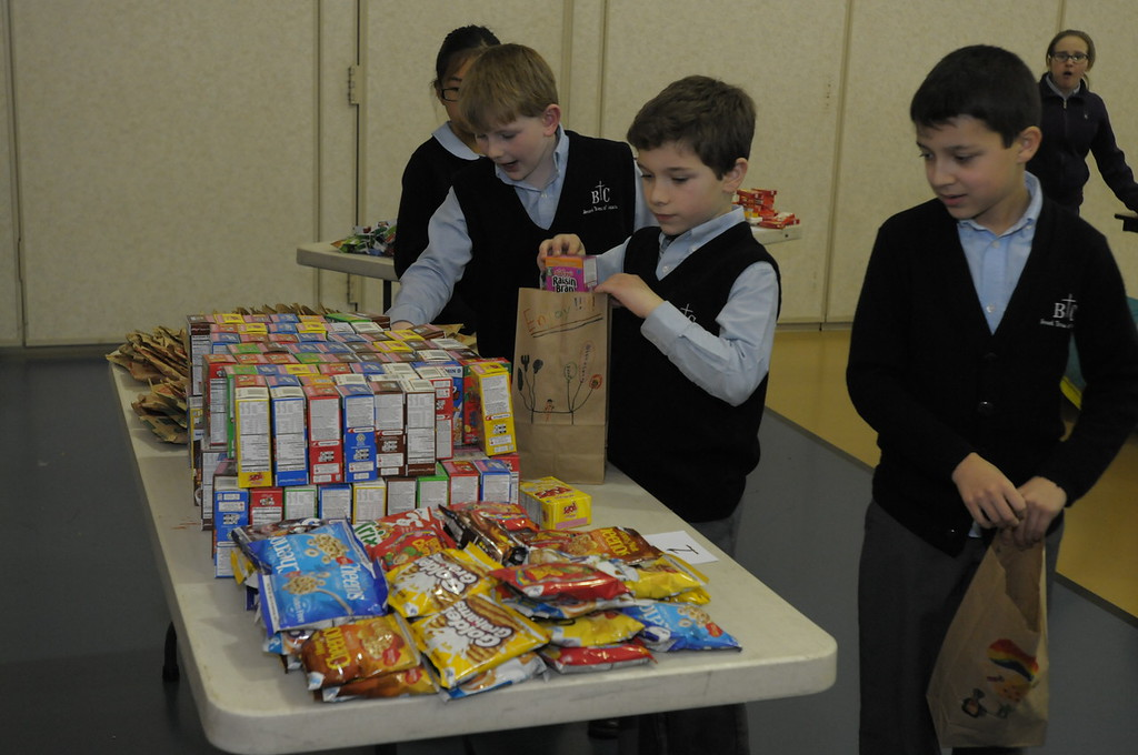 . St. Teresa of Calcutta students pack food bags for people in need during Catholic School Week February 2, 2017. Gene Walsh � Digital First Media