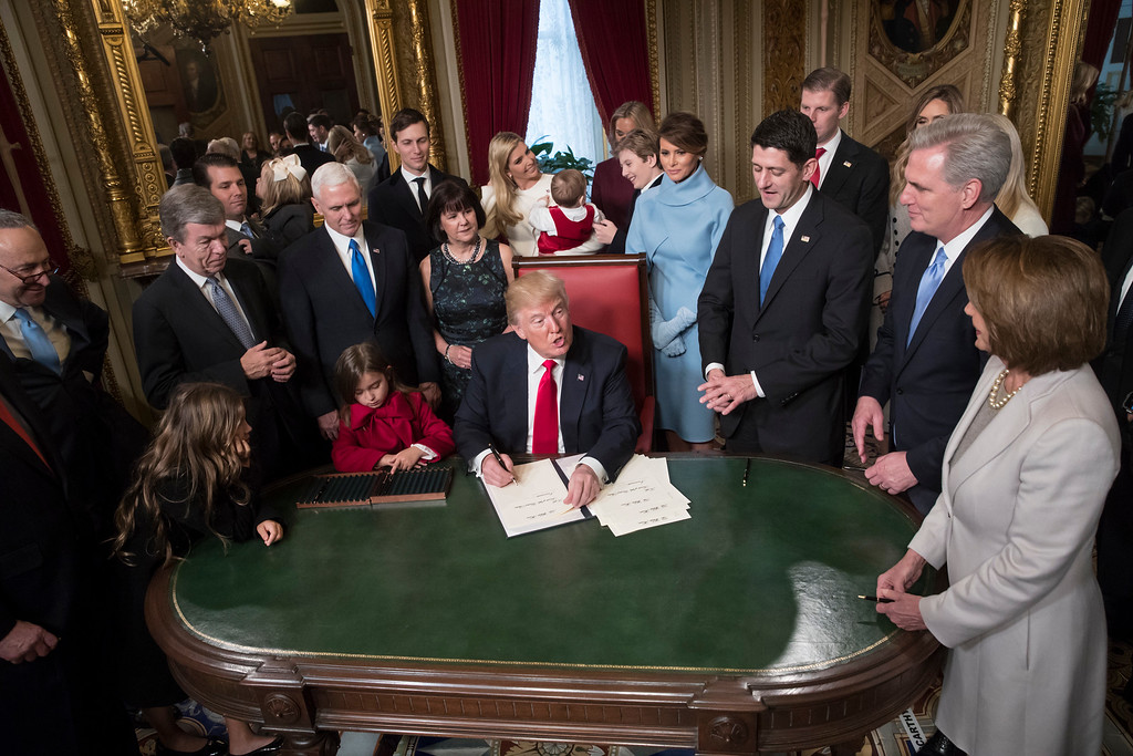 . President Donald Trump is joined by the Congressional leadership and his family as he formally signs his cabinet nominations into law, in the President\'s Room of the Senate, at the Capitol in Washington, Friday, Jan. 20, 2017. From left are Senate Minority Leader Chuck Schumer, D-N.Y., Sen. Roy Blunt, R-Mo., Donald Trump Jr., Vice President Mike Pence, Jared Kushner, Karen Pence, Ivanka Trump, Barron Trump, Melania Trump, Speaker of the House Paul Ryan, R-Wis., Majority Leader Kevin McCarthy, D-Calif., House Minority Leader Nancy Pelosi, D-Calif. (AP Photo/J. Scott Applewhite, Pool)