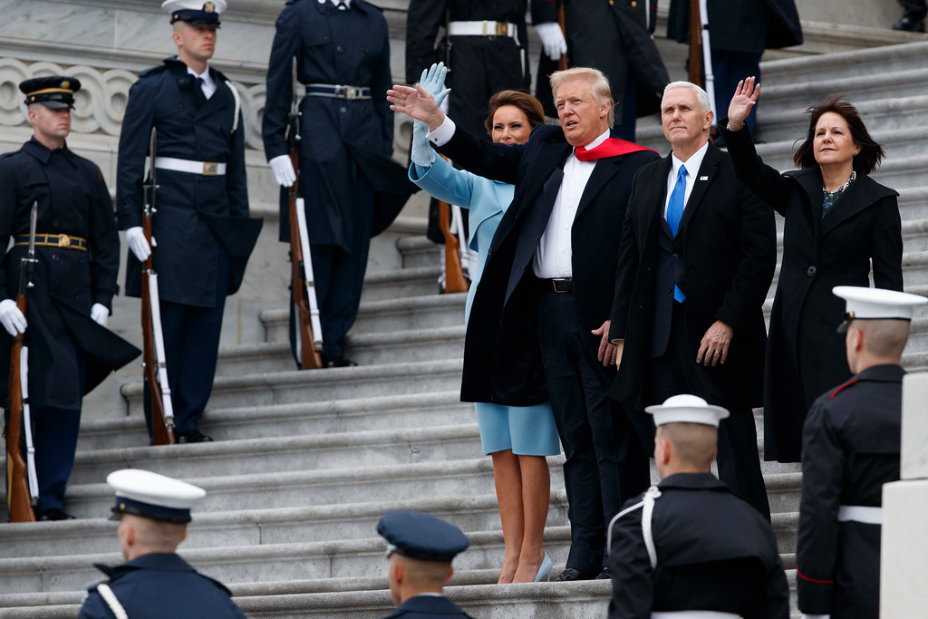 . Melania Trump, President Donald Trump, Vice President Mike Pence, and Karen Pence wave as former President Barack Obama departs the Capitol building, Friday, Jan. 20, 2017, in Washington. (AP Photo/Evan Vucci)
