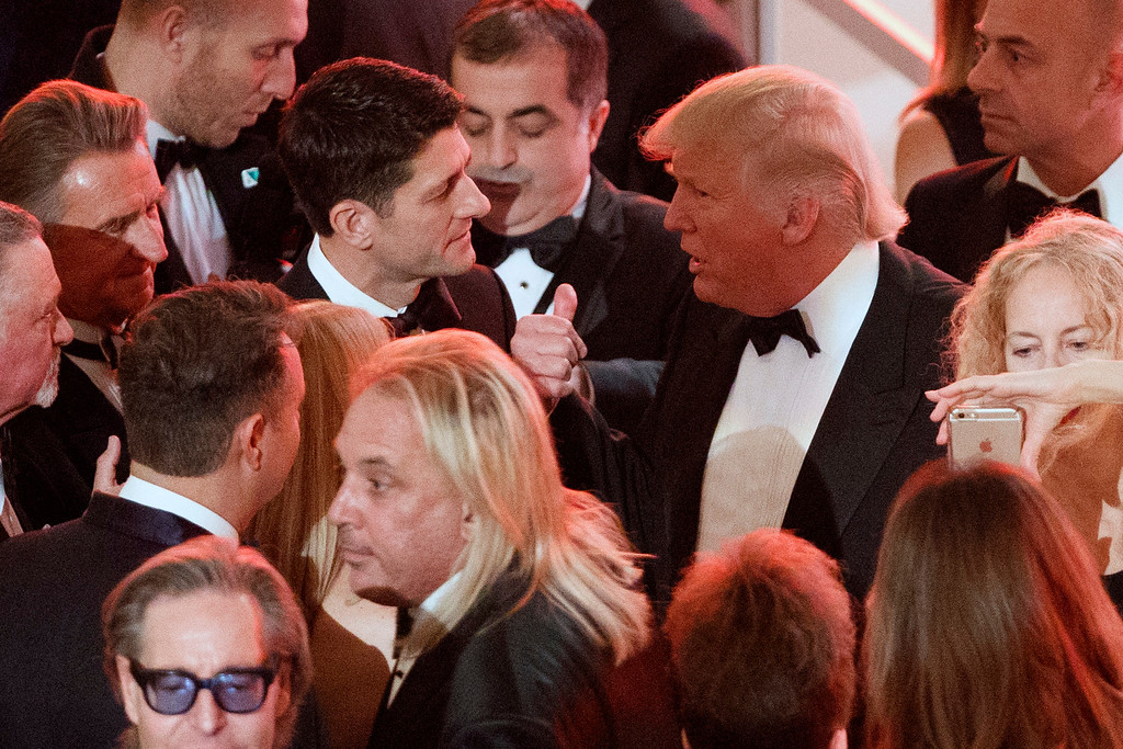 . President-elect Donald Trump talks with Speaker of the House Rep. Paul Ryan, R-Wis., during a VIP reception and dinner with donors, Thursday, Jan. 19, 2017, in Washington. (AP Photo/Evan Vucci)