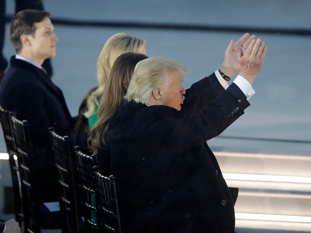 """. President-elect Donald Trump claps as he listens to music at a pre-Inaugural \""""Make America Great Again! Welcome Celebration\"""" at the Lincoln Memorial in Washington, Thursday, Jan. 19, 2017. (AP Photo/David J. Phillip)"""